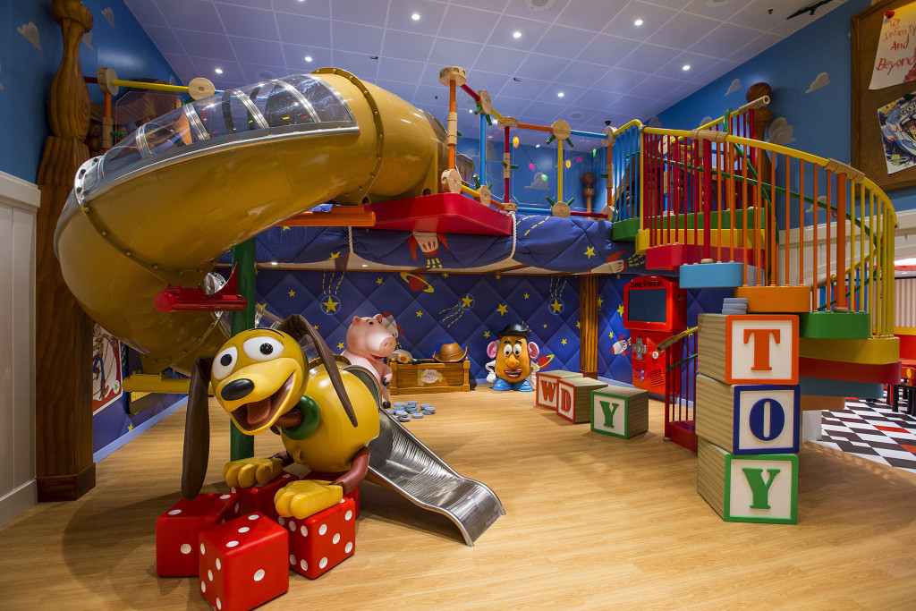 "Andy's Room, a new multi-level youth space in Disney's Oceaneer Club on the Disney Magic, brings the stars of the Disney-Pixar ""Toy Story"" film trilogy to life. Stocked with all of Andy's favorite toys, the room features a giant, working Mr. Potato Head, larger-than-life version of the lovable ""Toy Story"" piggy bank, Hamm, and Slinky Dog slide, the most fun way to descend to the toy room floor. (Matt Stroshane, photographer)"